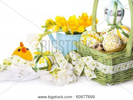 Easter eggs in green basket with chickens from felt