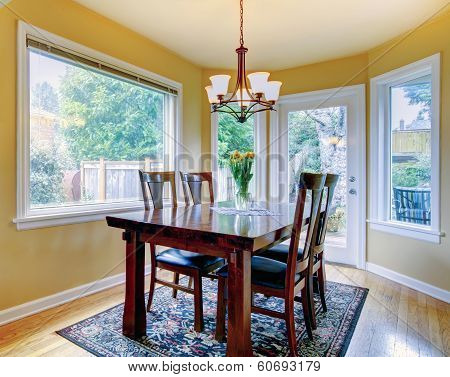 Cozy Small Dining Room With Walkout Deck