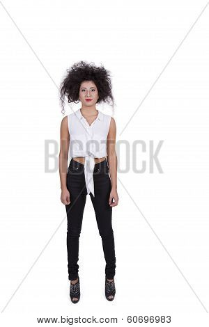 Attractive young female standing against white background