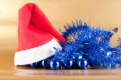 Red Santa Claus cap on Christmas decorations poster