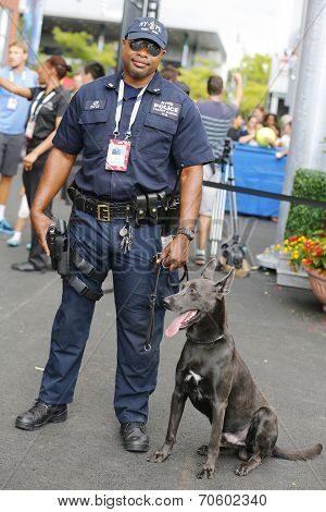 NYPD transit bureau K-9 police officer and Belgian Shepherd K-9 Sam  providing security at US Open