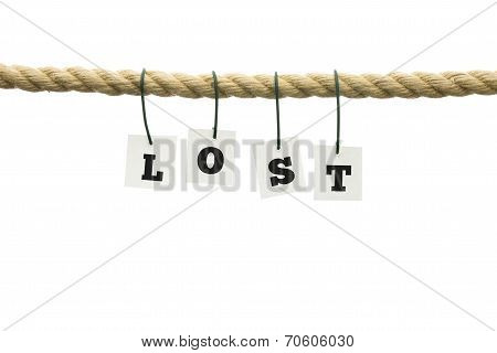 Word - Lost - Hanging From A Rope Over White