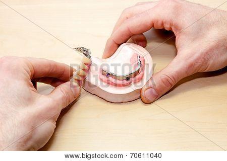 Artificial Facial Teeth On Wooden Table