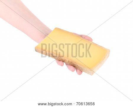 Piece of cheese in a man's hand.