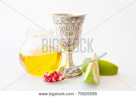 Rosh hashana Kiddush cup honey pomegranate and sliced apple