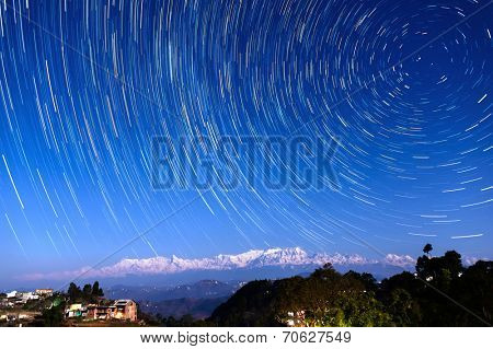 Star trails over Bandipur village and the Himalayas, Nepal poster