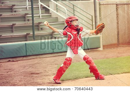 Catcher in baseball throwing the ball