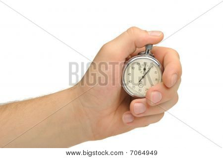 Man's Hand With A Stopwatch