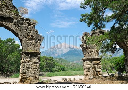 Ruins Of The Ancient City Of Phaselis And Olympus Mountain