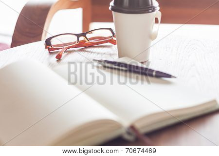 Eyeglasses With Coffee Cup In Coffee Shop