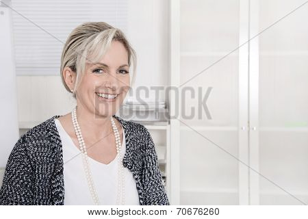 Attractive Blond Smiling Business Woman On White Background.