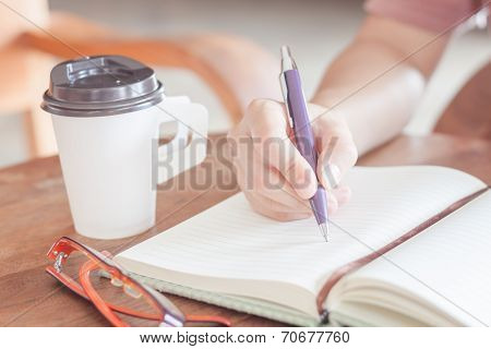 Woman Writing On Notepaper
