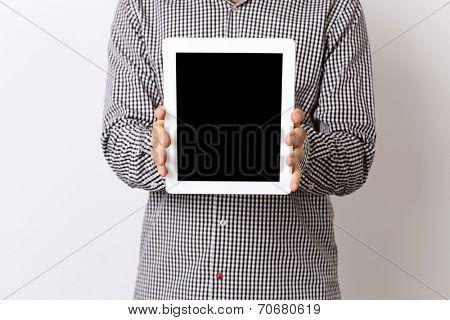 Closeup portrait of a man showing tablet comptuter screen