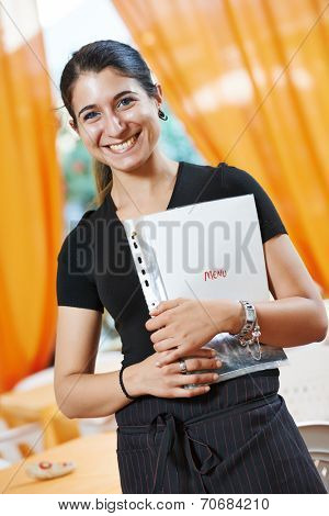 happy smiling waitress girl of commercial restaurant in uniform waiting an order with menu