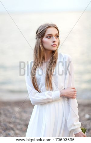 Portrait of beautiful woman near the water