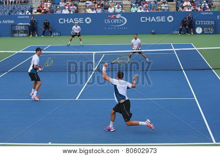 Grand Slam champions Mike and Bob Bryan (at the front) during US Open 2014 round 3 doubles match