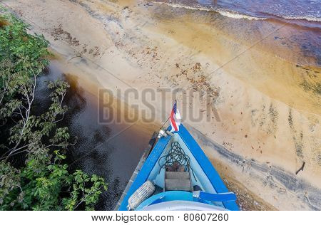 Boat arrives to sand beach