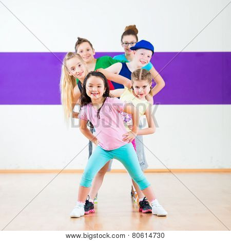 Children in zumba class dancing modern group choreography
