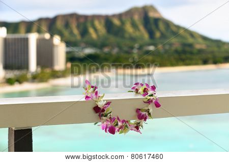 Hawaii travel icon: Lei flower necklace in front of Waikiki beach and Diamond Head state monument in Honolulu poster