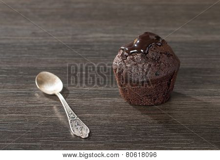 Spongecake Or Muffin With Chocolate Sauce
