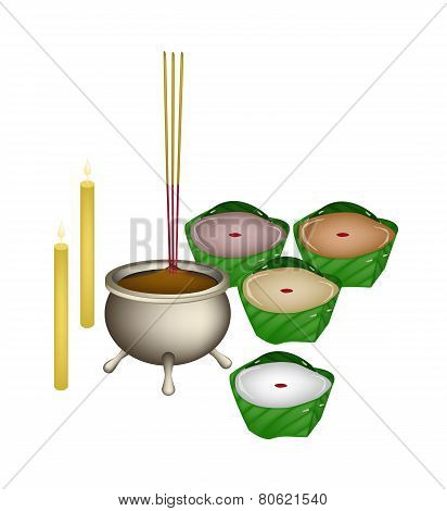 Chinese Pudding or Chinese Sweetmeat Made with Joss Sticks and Candles for Pay Respect to God in Chinese New Year. poster