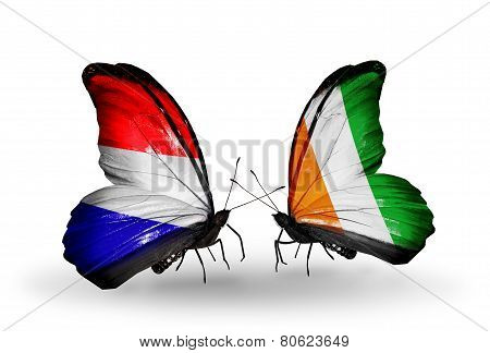 Two Butterflies With Flags On Wings As Symbol Of Relations Holland And Cote Divoire