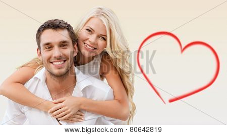 holiday, valentine's day, dating and love concept - happy couple having fun over beige background and red heart shape