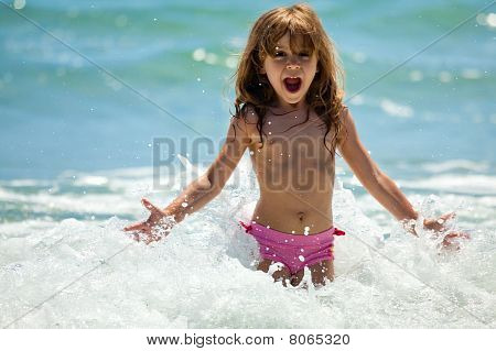 Little Girl At Sea In Sunny Day