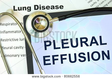 Tablet with word Pleural effusion and stethoscope.