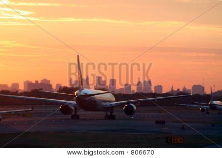 airplane before New York skyline