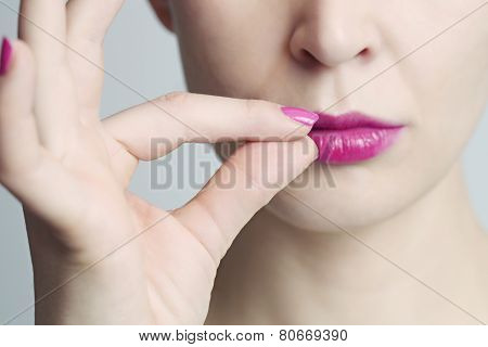 Woman zipping her mouth shut - keeping quiet concept poster