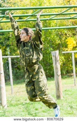 Teenage girl on climbing frame in relay
