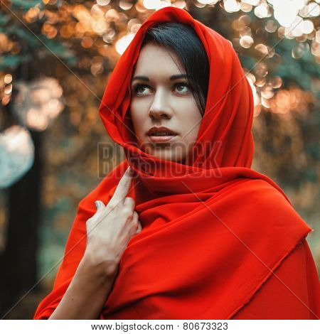 Girl In A Red Dress Standing In The Garden With Hearts