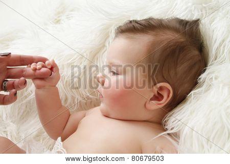 Newborn Baby Holding Mom's Hand