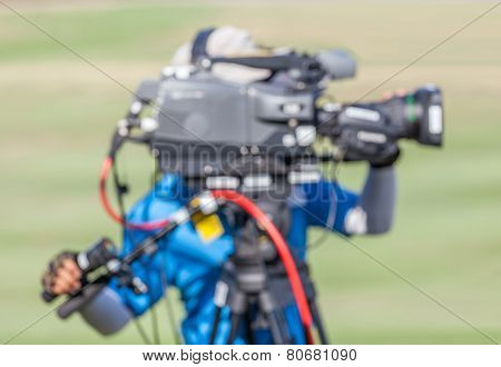 Blurred Image Of A Man Is Recording Vdo During Golf Tournament.