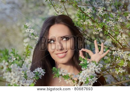 Woman with Allergy Holding Anti Allergic Pills in Spring Blooming Decor