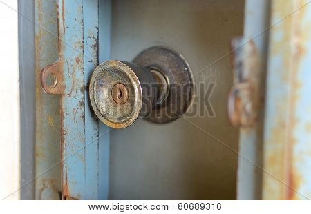 Old door knobs and a long scratch and rust.