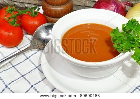 Tomato cream soup with parsley and mix up with