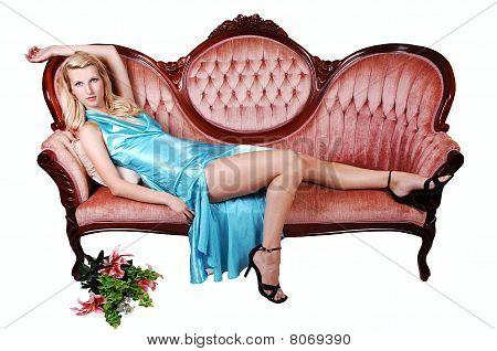 Beautiful Girl Lying On A Sofa.