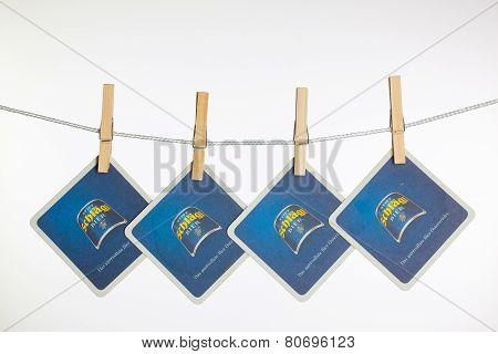 Beermats From Schlagl Beer Hanging From A Clothesline.