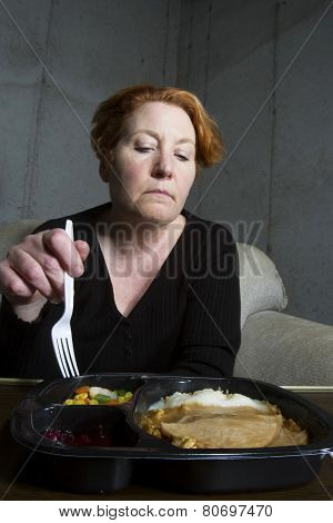 Middle Aged Woman Eating TV Dinner