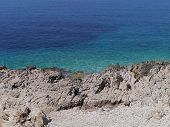The rough coast and the azure blue water of the Adriatic sea in Croatia poster