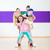 Children in zumba class dancing modern group choreography  poster