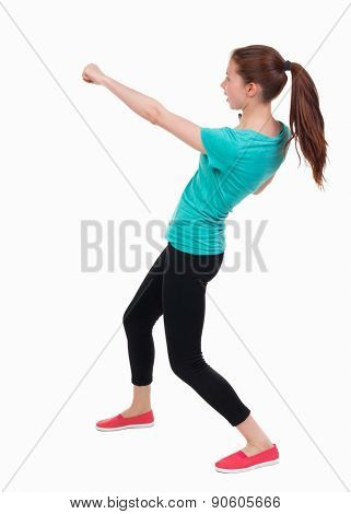 skinny woman funny fights waving his arms and legs. Rear view people collection.  backside view of person.  Isolated over white background. Girl in sportswear brushes hand.