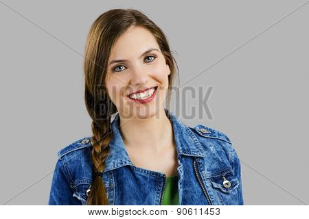 Portrait of a eautiful woman smiling over a grey background