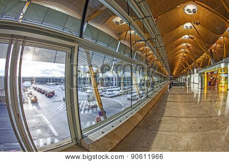 Passengers Walk By At The New Terminal T4 At Barajas Airport