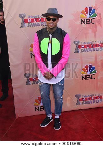 LOS ANGELES - MAR 29:  Chris Brown arrives to the 2015 iHeartRadio Music Awards  on March 29, 2015 in Hollywood, CA