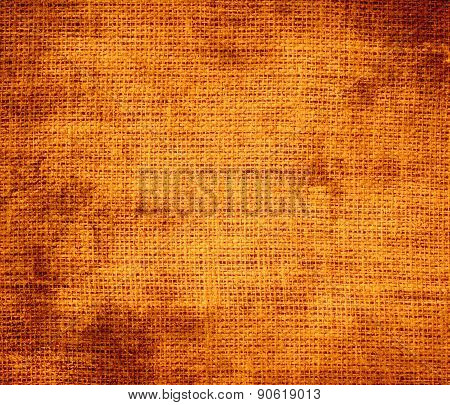 Grunge background of amber (SAE-ECE) burlap texture