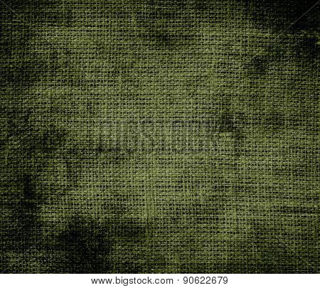 Grunge background of army green burlap texture
