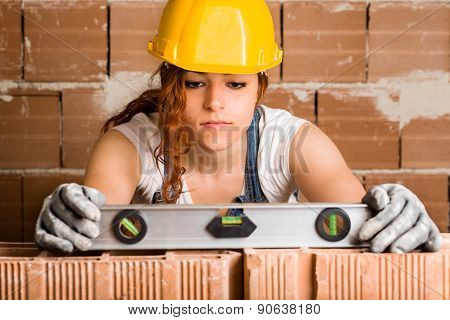 Woman Bricklayer with Spirit Level